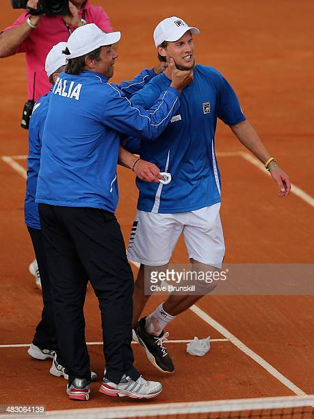 Andreas Seppi of Italy is congratulated by team members after winning the fifth and decisive rubber against James Ward of Great Britain during day...