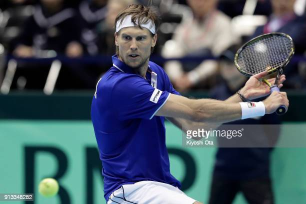 Andreas Seppi of Italy plays a backhand in his singles match against Yuichi Sugita of Japan during day one of the Davis Cup World Group first round...
