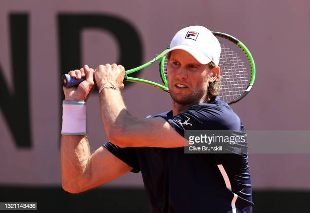 Andreas Seppi of italy plays a backhand in their mens first round match against Felix Auger Aliassime of Canada during day three of the 2021 French...