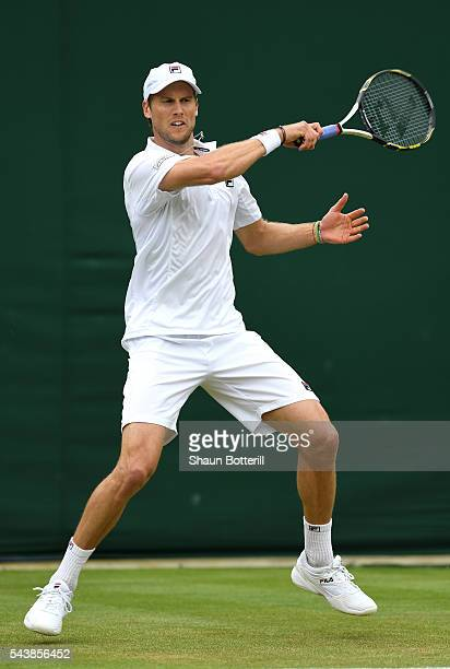 Andreas Seppi of Italy plays a forehand during the Men's Singles second round match against Milos Raonic of Canada on day four of the Wimbledon Lawn...