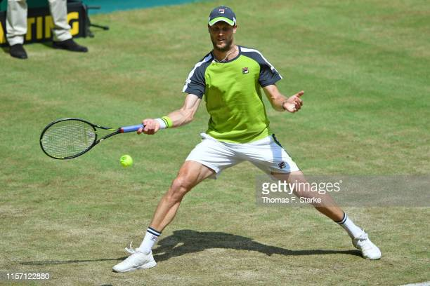 Andreas Seppi of Italy plays a forehand in his match against Matteo Berrettini of Italy during day 4 of the Noventi Open at Gerry Weber Stadium on...