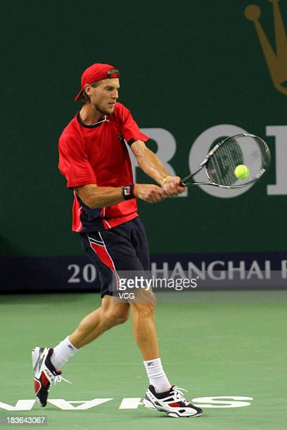 Andreas Seppi of Italy returns a ball to Lleyton Hewitt of Australia on day two of the Shanghai Rolex Masters at the Qi Zhong Tennis Center on...