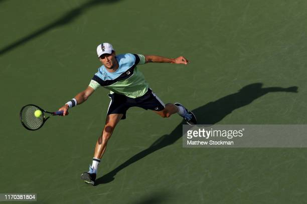 Andreas Seppi of Italy returns a shot during his men's singles first round match against Grigor Dimitrov of Bulgaria during day one of the 2019 US...