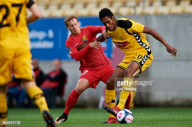 Andreas Skovgaard of FC Nordsjalland and Mikkel Qvist of AC Horsens compete for the ball during the Danish Alka Superliga match between AC Horsens...
