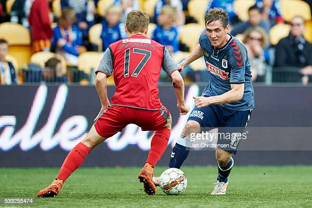 Andreas Skovgaard of FC Nordsjalland and Morten Rasmussen of AGF Arhus compete for the ball during the Danish Alka Superliga match between FC...