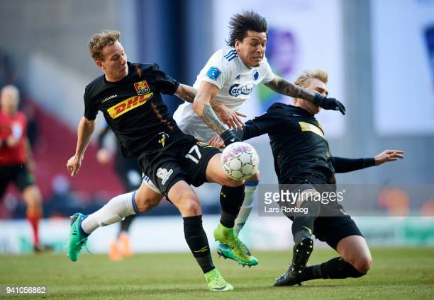 Andreas Skovgaard of FC Nordsjælland Federico Santander of FC Copenhagen and Victor Nelsson of FC Nordsjælland compete for the ball during the Danish...