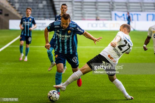 Andreas Skovgaard of Orebro SK strips Emir Kujovic of Djurgardens IF of the ball during an Allsvenskan match between Djurgardens IF and Orebro SK at...
