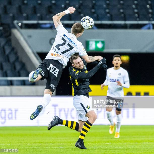 Andreas Skovgaard of Orebro SK wins heads the ball away from AIKs Filip Rogic during the Allsvenskan match between AIK and Orebro SK at Friends Arena...