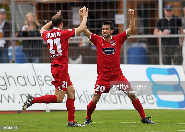 Andreas Spann and Alper Bageci of Heidenheim celebrate after scoring the opening goal during the third division match between Wacker Burghausen and...