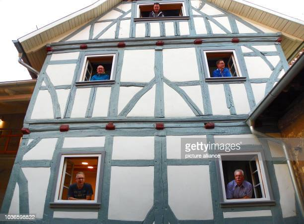 Andreas Uhlich Roland Schneider Markus Wehr Jens Offenbecher and Ulrich Woelm standing in the old part of Knorrsches Haus in Uder Germany 5 September...
