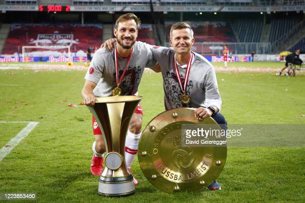 Andreas Ulmer and head coach Jesse Marsch of Salzburg celebrating the win of the Austrian football championships and the national soccer trophy after...