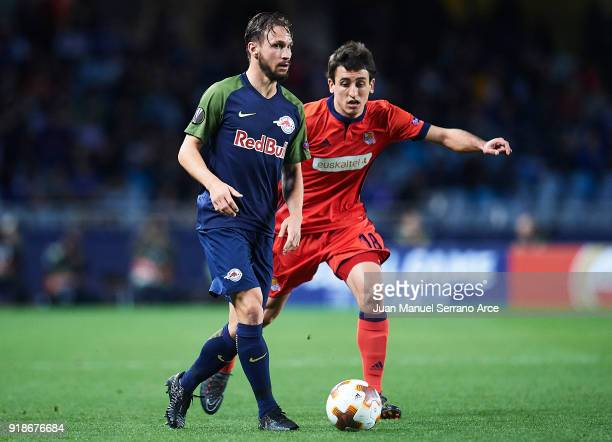 Andreas Ulmer of FC Red Bull Salzburg being followed by Mikel Oyarzabal of Real Sociedad during UEFA Europa League Round of 32 match between Real...