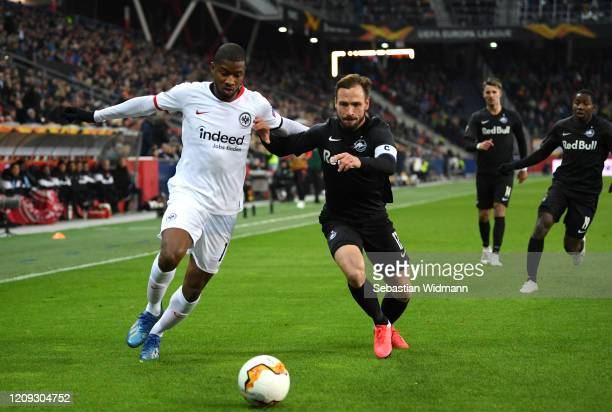 Andreas Ulmer of Salzburg and Almamy Toure of Frankfurt battle for possession during the UEFA Europa League round of 32 second leg match between RB...
