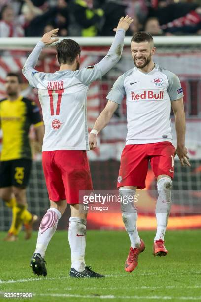 Andreas Ulmer of Salzburg and Valon Berisha of Salzburg celebrate after winning UEFA Europa League Round of 16 second leg match between FC Red Bull...