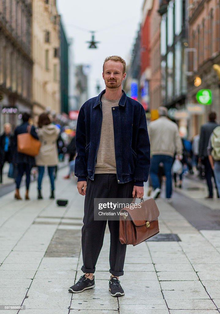 Andreas Uneby Wearing A Blue Denim Jacket Dark Jogger Pants Beige