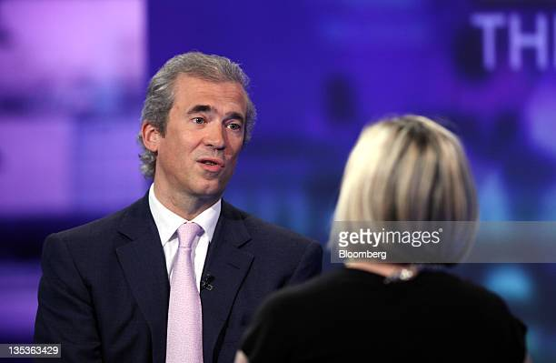 Andreas Utermann chief investment officer of Allianz Global Investors part of Allianz SE left speaks during a television interview in London UK on...