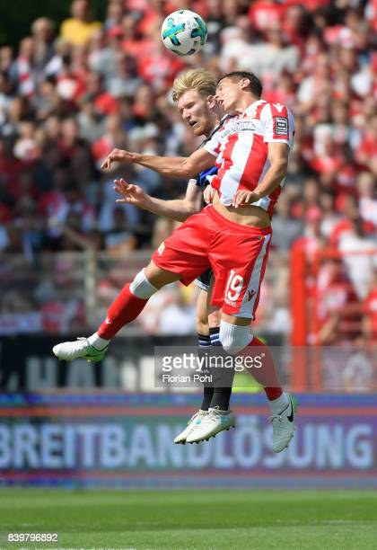 Andreas Voglsammer of Arminia Bielefeld and Damir Kreilach of 1 FC Union Berlin during the game between Union Berlin and Arminia Bilefeld on august...