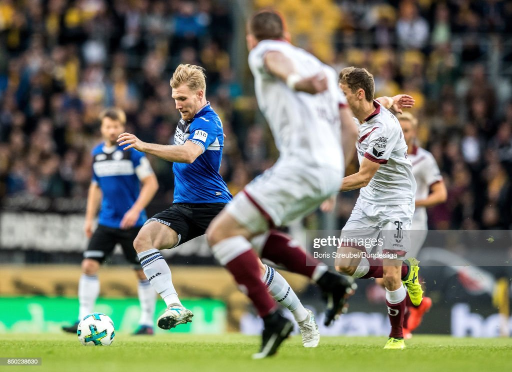 Andreas Voglsammer of Arminia Bielefeld in action with Sören Gonther of SG DYnamo Dresden and Fabian Mueller of SG DYnamo Dresden during the Second Bundesliga match between SG Dynamo Dresden and DSC Arminia Bielefeld at DDV-Stadion on September 20, 2017 in Dresden, Germany.