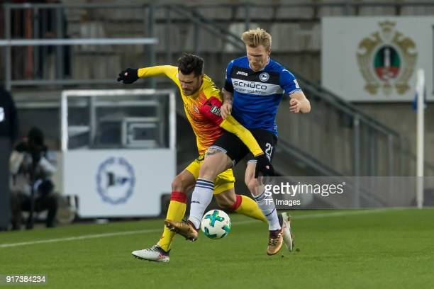 Andreas Voglsammer of Bielefeld and Christopher Trimmel of Berlin battle for the ball during the Second Bundesliga match between Arminia Bielefeld...
