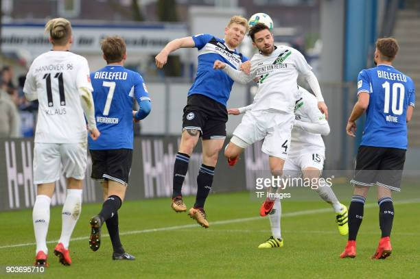 Andreas Voglsammer of Bielefeld and Julian Korb of Hannover battle for the ball during the HHotelscom Wintercup match between Arminia Bielefeld and...