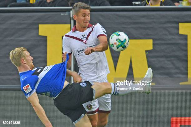 Andreas Voglsammer of Bielefeld and Paul Seguin of Dresden fight for the ball during the Second Bundesliga match between SG Dynamo Dresden and DSC...