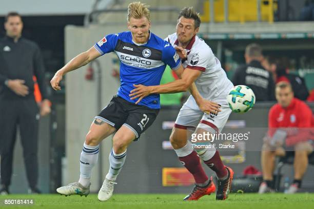Andreas Voglsammer of Bielefeld and Soeren Gonther of Dresden fight for the ball during the Second Bundesliga match between SG Dynamo Dresden and DSC...