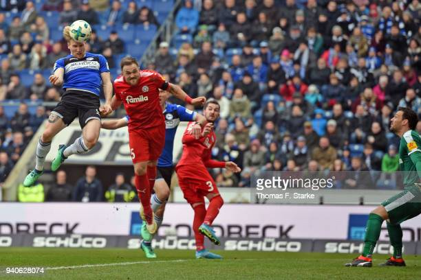 Andreas Voglsammer of Bielefeld heads the ball prior to Rafael Czichos of Kiel during the Second Bundesliga match between DSC Arminia Bielefeld and...