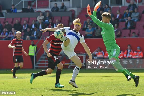 Andreas Voglsammer of Bielefeld scores against goalkeeper Oerjan Nyland of Ingolstadt during the Second Bundesliga match between FC Ingolstadt 04 and...