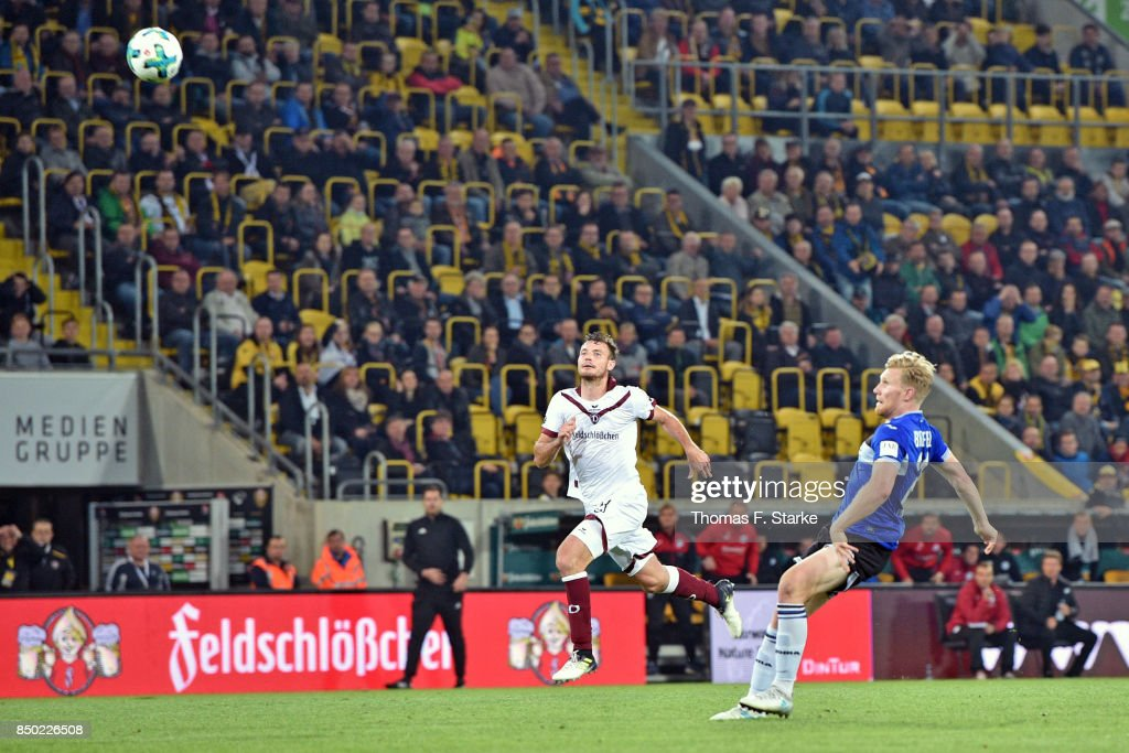 Andreas Voglsammer (R) of Bielefeld scores his teams first goal during the Second Bundesliga match between SG Dynamo Dresden and DSC Arminia Bielefeld at DDV-Stadion on September 20, 2017 in Dresden, Germany.