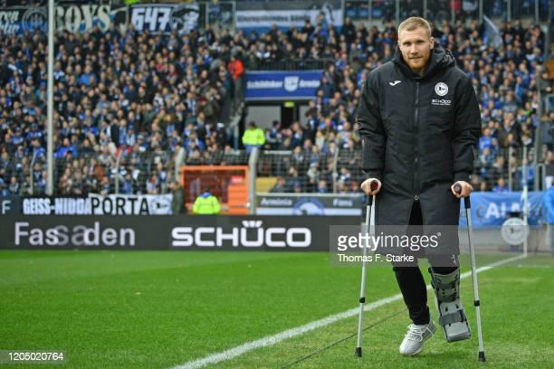 Andreas Voglsammer of Bielefeld walks on crutches prior to the Second Bundesliga match between DSC Arminia Bielefeld and SSV Jahn Regensburg at...