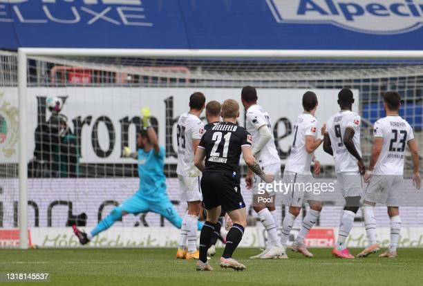 Andreas Voglsammer of DSC Arminia Bielefeld scores their side's first goal during the Bundesliga match between DSC Arminia Bielefeld and TSG...