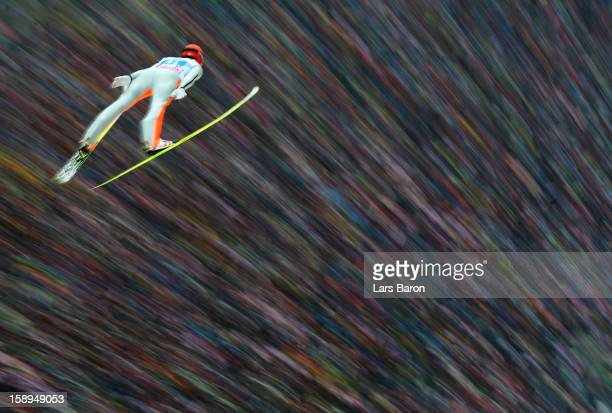 Andreas Wank of Germany competes during the first round for the FIS Ski Jumping World Cup event of the 61st Four Hills ski jumping tournament at...
