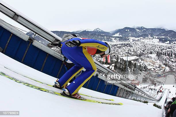 Andreas Wank of Germany competes during the training round for the FIS Ski Jumping World Cup event at the 59th Four Hills ski jumping tournament at...