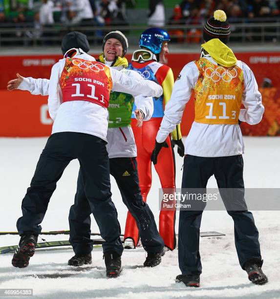 Andreas Wank of Germany Marinus Kraus of Germany and Andreas Wellinger of Germany celebrate after the Men's Team Ski Jumping final round on day 10 of...