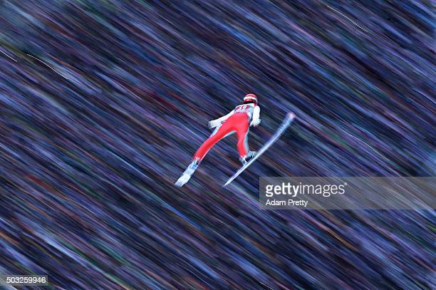 Andreas Wank of Germany soars through the air and over the grandstand during his final competition jump on day 2 of the Innsbruck 64th Four Hills...