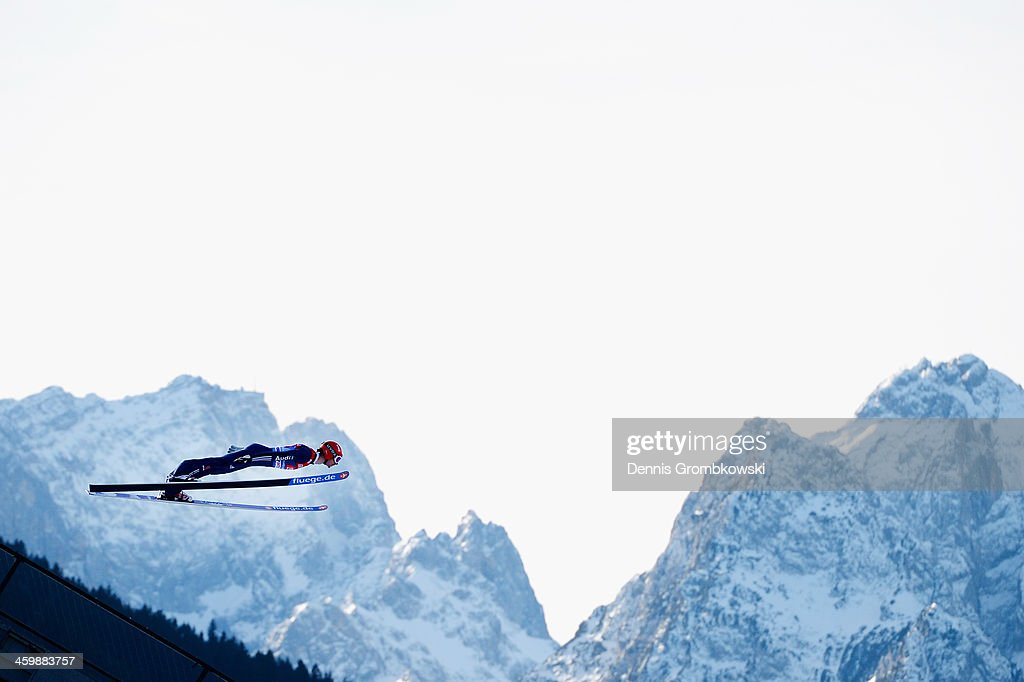 Andreas Wank of Germany soars through the air during his training jump at Olympia Skistadion on January 1, 2014 in Garmisch-Partenkirchen, Germany.