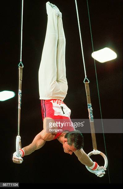 Andreas Wecker of Germany performes on the still rings during the World Championship on September 08 1991 in Indianapolis United States