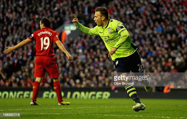 Andreas Weimann of Aston Villa celebrates after scoring the second goal during the Barclays Premier League match between Liverpool and Aston Villa at...