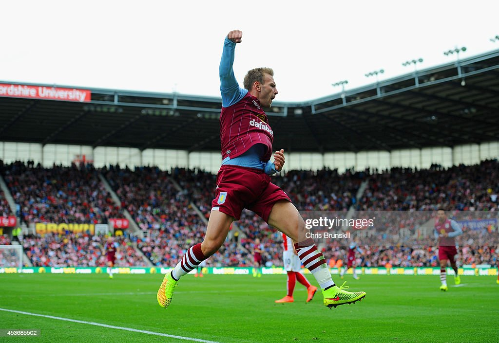 Andreas Weimann of Aston Villa celebrates scoring the opening goal during the Barclays Premier League match between Stoke City and Aston Villa at Britannia Stadium on August 16, 2014 in Stoke on Trent, England.