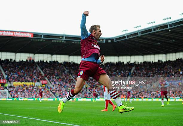 Andreas Weimann of Aston Villa celebrates scoring the opening goal during the Barclays Premier League match between Stoke City and Aston Villa at...