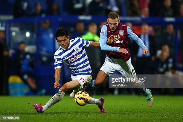 Andreas Weimann of Aston Villa challenges Yoon SukYoung of QPR during the Barclays Premier League match between Queens Park Rangers and Aston Villa...
