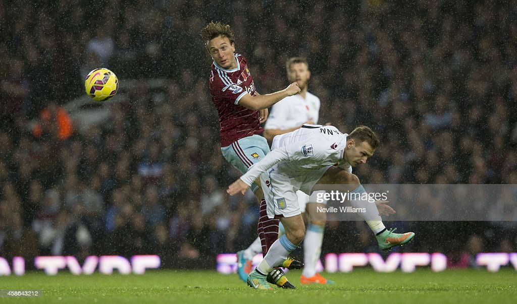 Andreas Weimann of Aston Villa is challenged by Mark Noble of West Ham United during the Barclays Premier League match between West Ham United and Aston Villa at the Boleyn Ground on November 08, 2014 in London, England.
