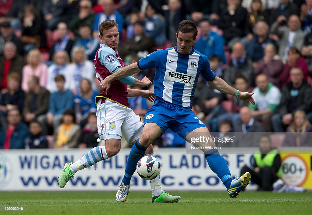 Andreas Weimann of Aston Villa is challenged by Roman Golobart of Wigan Athletic during the Barclays Premier League match between Wigan Athletic and Aston Villa at DW Stadium on May 19, 2013 in Wigan, England.