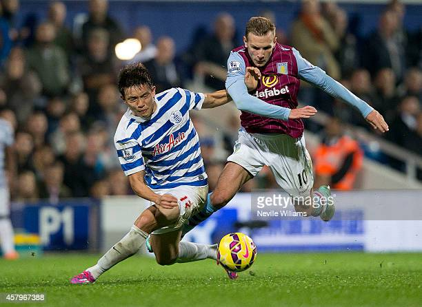 Andreas Weimann of Aston Villa is challenged by Suk Young Yun of Queens Park Rangers during the Barclays Premier League match between Queens Park...