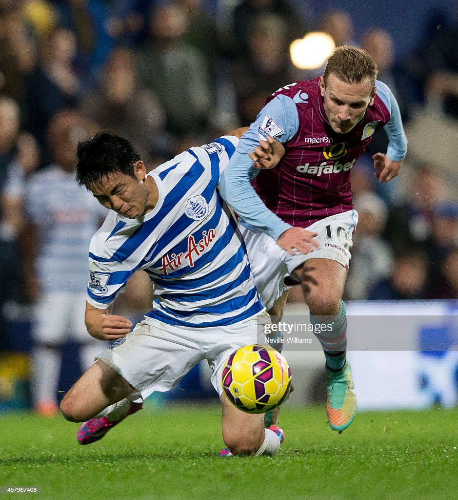 Andreas Weimann of Aston Villa is challenged by Suk Young Yun of Queens Park Rangers during the Barclays Premier League match between Queens Park Rangers and Aston Villa at Loftus Road on October 27, 2014 in London, England.