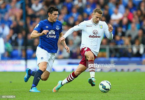 Andreas Weimann of Aston Villa is closed down by Gareth Barry of Everton during the Barclays Premier League match between Everton and Aston Villa at...