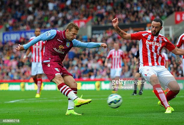 Andreas Weimann of Aston Villa scores the opening goal during the Barclays Premier League match between Stoke City and Aston Villa at Britannia...