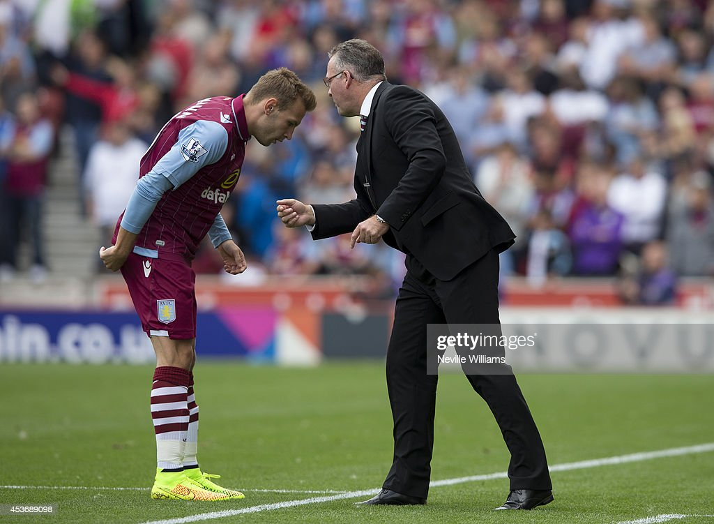 Andreas Weimann (L) of Aston Villa speaks to Paul Lambert, manager of Aston Villa during the Barclays Premier League match between Stoke City and Aston Villa at the Britannia Stadium on August 16, 2014 in Stoke on Trent, England.