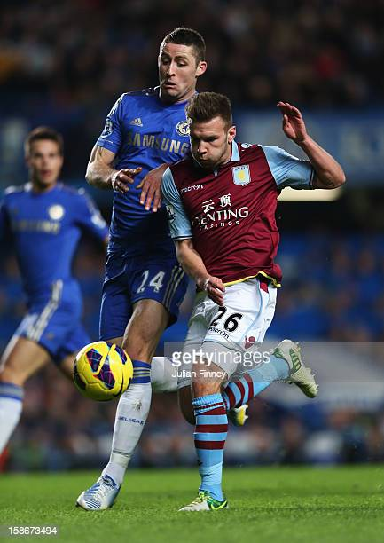Andreas Weimann of Aston Villa takes on Gary Cahill of Chelsea during the Barclays Premier League match between Chelsea and Aston Villa at Stamford...