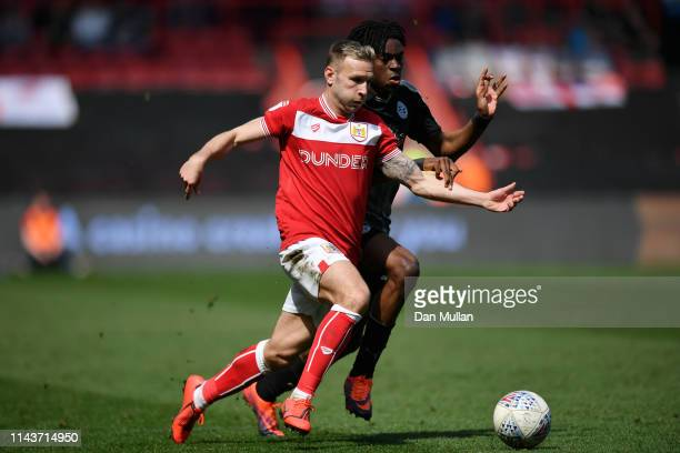 Andreas Weimann of Bristol City battles for possession with Ovie Ejaria of Reading during the Sky Bet Championship match between Bristol City and...